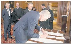 ?? Franz Jantzen/Public Information Office Supreme Court ?? Neil Gorsuch signed the Constitutional Oath on Monday. Besides dealing with the court's weighty legal matters, Gorsuch will serve on the cafeteria committee. He also must take notes and answer the door at the court's private meetings.