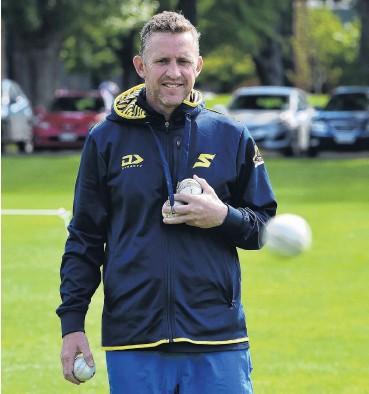?? PHOTO GREGOR RICHARDSON ?? Gathering seam . . . Otago Sparks coach Craig Cumming retrieves some balls during a training session at Logan Park earlier this week.