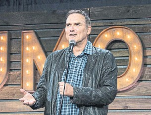 """?? AMY HARRIS INVISION/THE ASSOCIATED PRESS FILE PHOTO ?? Norm Macdonald performs a standup set in San Diego in 2017. Macdonald, a former cast member on """"Saturday Night Live,"""" died Tuesday, after a nine-year battle with cancer. He was 61."""