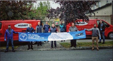 ??  ?? Emmet Grogan and team helped members of the East Meath Cardiac Response Unit install a new defibrillator at Deepforde estate.