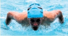 ??  ?? Matthew Rottcher competed in the boys 100m butterfly event