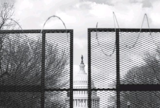 ?? AMANDA ANDRADE-RHOADES FOR THE WASHINGTON POST ?? Fencing was among the additional security measures taken after supporters of President Donald Trump stormed the Capitol in early January, and it will be reinstalled this week before a related event.