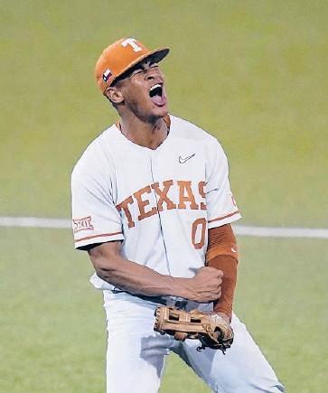 ?? ERIC GAY/AP ?? Shortstop Trey Faltine celebrates during Texas' super regional victory over South Florida on Sunday.