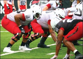 ??  ?? Senior Avery Demmons (left), a 6-6, 300-pound lineman who appeared in seven games in 2020, has caught the attention of Arkansas State coaches for his progression this spring.