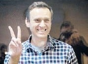 ?? ALEXANDER ZEMLIANICHENKO/AP ?? Alexei Navalny, shown gesturing Feb. 20 in court, has been sent to a penal colony.