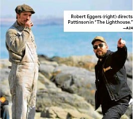 """?? —A24 ?? Robert Eggers (right) directs Pattinson in """"The Lighthouse."""""""