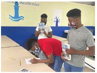 ?? (Special to The Commercial) ?? Pine Bluff Lighthouse Academy Charter School students sign the noviolence pledge.