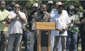 ?? BRIAN RICH/SUN-TIMES ?? Jalon Arthur, director of strategic initiatives for Chicago CRED, speaks at an anti-violence rally Tuesday in Douglass Park.