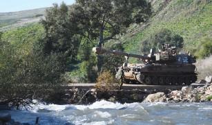 ?? (IDF) ?? AN IDF artillery battery crosses a bridge near the Israel-Lebanon border.
