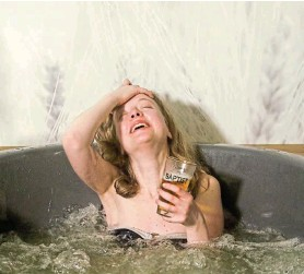 ?? Photograph: YVES HERMAN/REUTERS ?? BUBBLE TROUBLE: Brussels yoga teacher Dorien Dierckx enjoys a beer while relaxing in a jacuzzi full of hot water mixed with beer ingredients