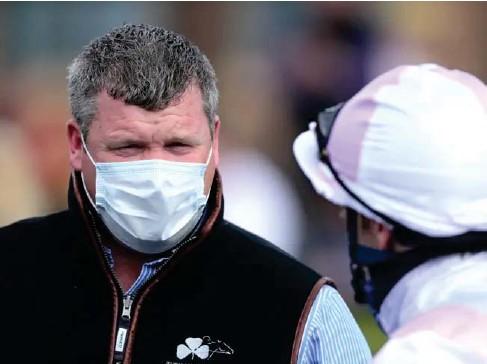 ?? (PA) ?? Trainer Gordon E ll iott with jockey Dec l an McDonogh at Punchestown racecourse yesterday