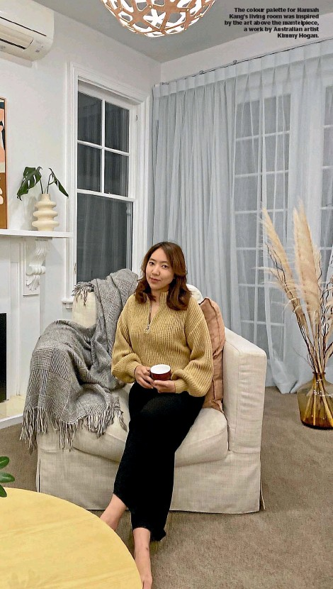 ??  ?? The colour palette for Hannah Kang's living room was inspired by the art above the mantelpiece, a work by Australian artist Kimmy Hogan.