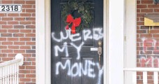 ?? TIMOTHYD.EASLEY/AP ?? Graffiti is seen on a door of the home of Senate Majority Leader Mitch McConnell on Saturday in Louisville, Kentucky.