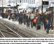 ?? EPA-Yonhap ?? Railways passengers walk along platforms during an SNCF French national railways strike at Gare de Lyon train station in Paris, Monday. A three months' national strike is called by railways labor unions to defend their rights, as French President...