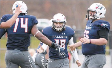 ?? CHRISTOPHER DOLAN / STAFF PHOTOGRAPHER ?? Lackawanna kicker and Valley View graduate Cam Ceccotti, center, celebrates his extra point with Tre-quan Dorsey, left, and Valley View graduate Brian Durkin during Sunday's game against Georgia Military College.