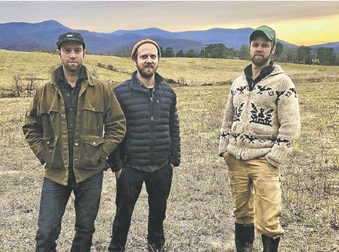 "?? BY JOHN MCCASLIN ?? Jen­nings, Lain and Van Car­ney, seen here this week sur­vey­ing the fu­ture site of their farm brew­ery and win­ery, are ""thrilled"" to take their Sper­ryville en­ter­prise in an ""es­tate grown"" di­rec­tion."