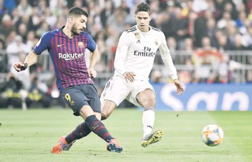 Barcelona s Uruguayan forward Luis Suarez (left) vies with Real Madrid s  French defender Raphael Varane during the Spanish Copa del Rey (King s Cup)  ... c3b6fa81e15c5