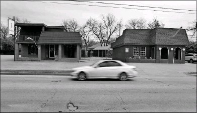 ?? Ron Baselice/Staff Photographer ?? North Henderson Avenue has newer and established stores but also pockets of blight, which are ticketed for transformation.