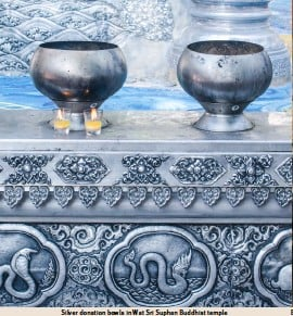 ??  ?? Silver donation bowls in Wat Sri Suphan Buddhist temple
