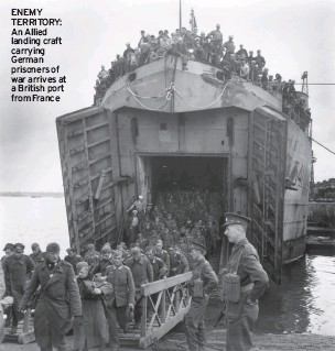??  ?? ENEMY TERRITORY: An Allied landing craft carrying German prisoners of war arrives at a British port from France