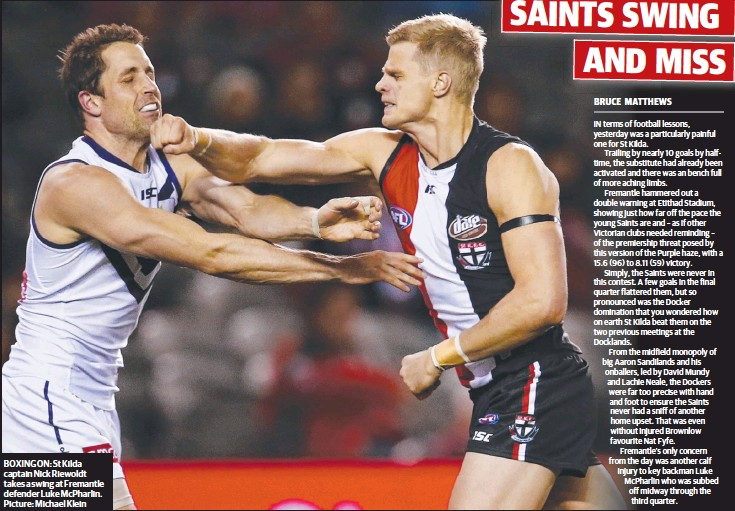 ??  ?? BOXING ON: St Kilda captain Nick Riewoldt takes a swing at Fremantle defender Luke McPharlin. Picture: Michael Klein
