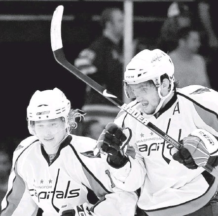 ?? TONI L. SANDYS/THE WASHINGTON POST ?? Nicklas Backstrom, left, and Alex Ovechkin are seen in their younger days, here celebrating a playoff victory over the Rangers in 2009.