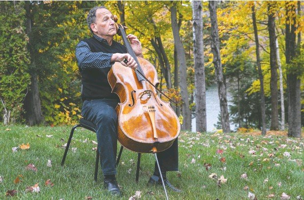 ?? Pierre Obendrauf / Postmedia News ?? From his lakefront home in St Sauveur, cellist Denis Brott plays Bach while remembering his fight with and convalescence from COVID-19.