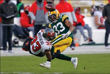 ?? The Associated Press ?? Green Bay Packers' Aaron Jones fumbles after being hit by Tampa Bay Buccaneers' Jordan Whitehead during the second half of the NFC championship in Green Bay, Wis., on Sunday.