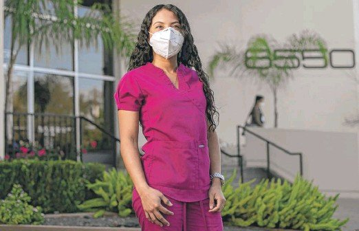 ?? BRANDON THIBODEAUX/KHN ?? Sussy Obando graduated from six years of medical school in Colombia, then spent a year treating patients in underserved communities. When she moved to the United States, that wasn't enough to be able to practice medicine in this country. She's now assisting with COVID-19 vaccine clinical trials.