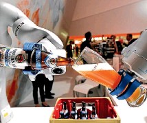?? FABIAN BIMMER ?? A robot fills a glass with beer at the booth of German company Kuka at the world's biggest industrial fair in Hanover, Germany.