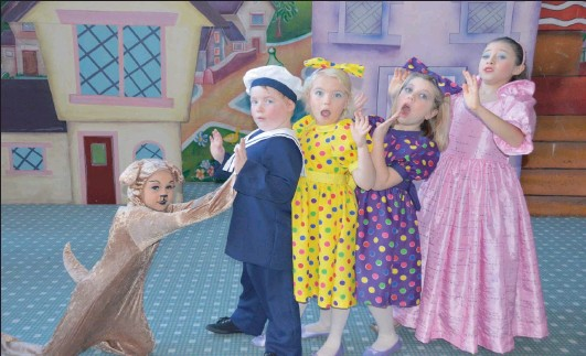??  ?? CLUMSY: Bumpy gets to knock over all the dolls. Making the most of sharing all the limelight are Bumpy Dog (Shani Sachs), Sailor Doll (Shane Haupt), Doll in spotted yellow dress (Anna Gardner), Doll in purple dress (Sophia Turner) and Mrs Doll (Sarah...