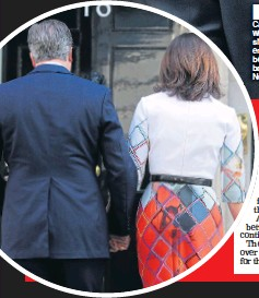 ??  ??    CHOKER: PM Mr Cameron and wife Samantha show their emotions before going back inside Number 10
