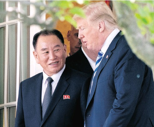 ?? ANDREW HARNIK / THE ASSOCIATED PRESS ?? President Donald Trump talks with Kim Yong Chol, former North Korean military intelligence chief and one of leader Kim Jong Un's closest aides, as they walk from their meeting in the Oval Office of the White House on Friday.
