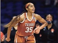 ?? Elsa / Getty Images ?? Texas' Charli Collier celebrates the lead late in the fourth quarter against Maryland during the Sweet Sixteen round of the Women's NCAA Tournament at the Alamodome in March in San Antonio.