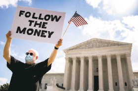 ?? Andrew Harnik / Associated Press 2020 ?? A demonstrator stands at the Supreme Court last July in Washington during a previous ruling over former President Donald Trump's financial records.