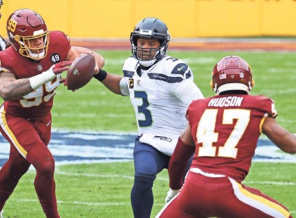 ?? GEOFF BURKE/USA TODAY SPORTS ?? Russell Wilson has started every Seahawks game in his nine-year NFL career.