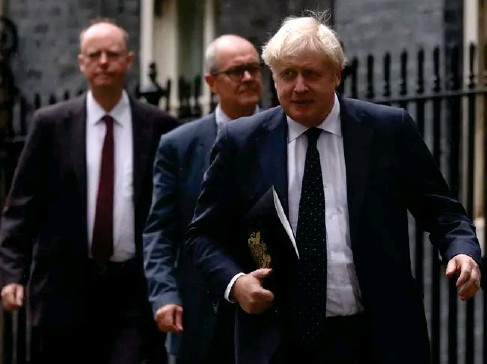 ?? (AFP) ?? Boris Johnson, Patrick Va ll ance and Chris Whitty on their way to a press briefing yesterday
