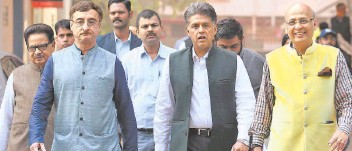 ?? SANDEEP SAXENA ■ ?? Raising concern: Congress leaders Manish Tewari, Abhishek Manu Singhvi and P.L. Punia coming out after submitting a memorandum to the Election Commission in New Delhi on Saturday.