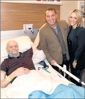 ??  ?? KIND GESTURE: Rangers fan Billy meets Brendan Rodgers and fiancée Charlotte Searle. Picture: William Cherry