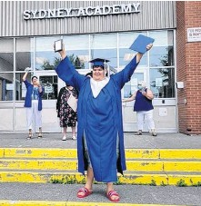 ?? CONTRIBUTED ?? Gregory Francis stands on the front steps of Sydney Academy after walking the stage at his graduation on June 22, holding his diploma in one hand and his plaque for making highest honours for the past three years.