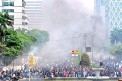 ??  ?? Smoke rises from fires set by ac­tivists dur­ing protests in Jakarta