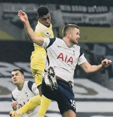 ??  ?? Fulham's Ivan Cavaleiro out jumps Eric Dier to score the equalising goal.