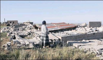 ?? PICTURE: GCINA NDWALANE ?? Durban pensioner Zukiswa Young, 66, looks at the remains of her home in Cato Ridge, which was demolished by eThekwini municipality officials on Thursday.