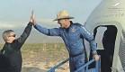 ?? BLUE ORIGIN/ AFP VIA GETTY IMAGES ?? Billionaire Jeff Bezos exits the Blue Origin reusable New Shepard capsule after landing Tuesday in West Texas.