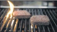 ?? 2019, PATRICK T. FALLON/BLOOMBERG NEWS ?? Impossible Foods has grabbed a chunk of the plant-based meat market thanks to its Impossible Burger.