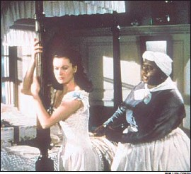 """?? New Line Cinema ?? VIVIEN LEIGH, left, and Hattie McDaniel in """"GoneWith theWind,"""" the domestic box-office champ, which won eight competitive Academy Awards."""