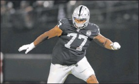 ?? Peter Joneleit The Associated Press ?? Raiders offensive tackle Trent Brown, shown Sept. 9 in Oakland, Calif., is listed as questionable for Sunday's game at Minnesota because of a knee injury.