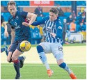 ??  ?? Killie's Kyle Lafferty and Keith Watson (County) tussle for the ball