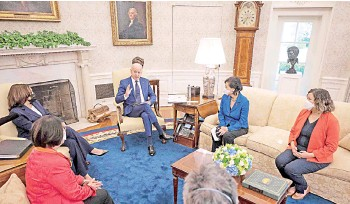 ?? — AFP photo ?? Biden (centre right) and Harris (left) meet with the Congressional Asian Pacific American Caucus Executive Committee at the White House in Washington, DC.