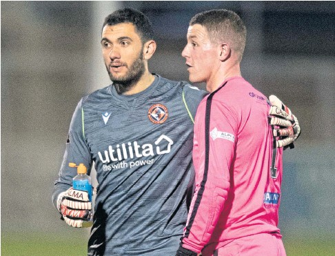 ??  ?? STARTING ROLE: Deniz Mehmet with Forfar opposite number Marc Mccallum after United's cup win.